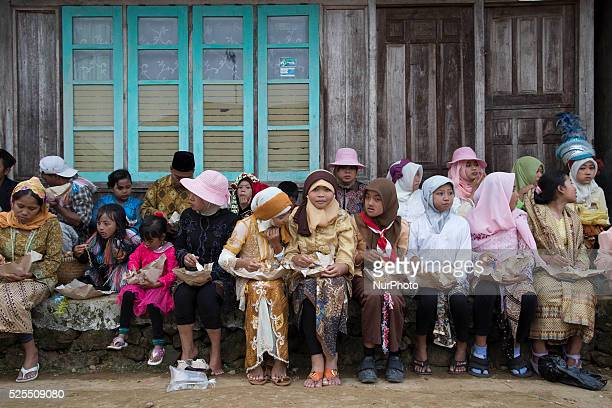 Women participant eating together after the karnivale festival at Dieng Dieng plateau in Central Java is part of the district of Banjarnegara and...