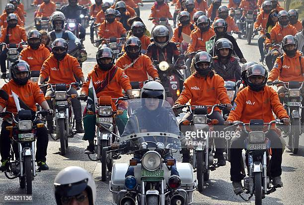 Women participants of Women on Wheels ride their motorbikes during a rally launching the Women on Wheels campaign in Lahore on January 10 2016 AFP...