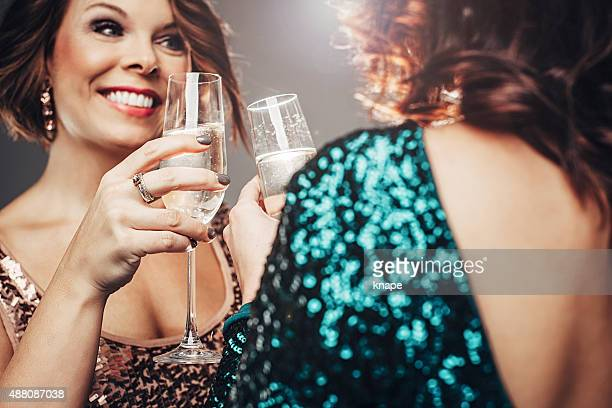 Women partying with drinking champagne