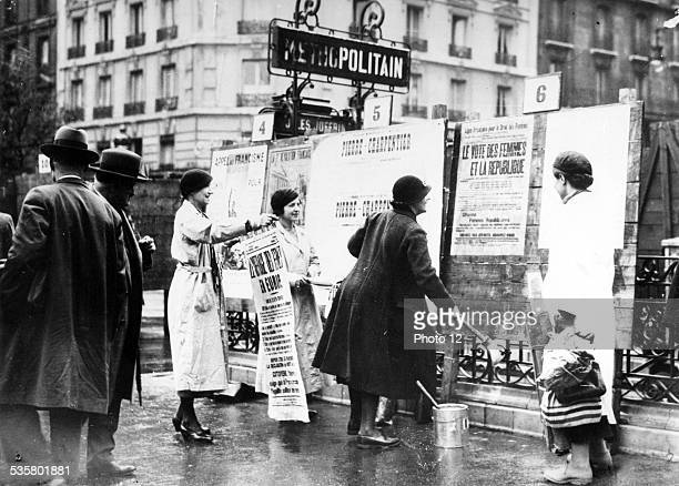 Women pasting posters in Paris for the vote of women Paris 1930s