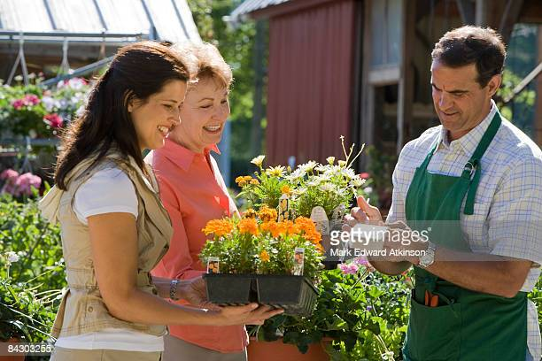 Women paying for flowers