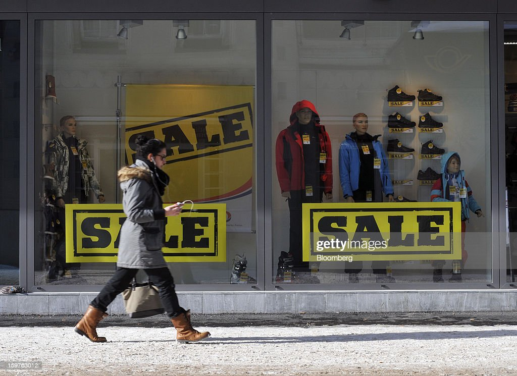 A women pedestrian walks past goods reduced for sale in the window of a sports store in the town of Davos, Switzerland, on Saturday, Jan. 19, 2013. Next week the business elite gathers in the Swiss Alps for the 43rd annual meeting of the World Economic Forum in Davos, the five day event runs from Jan. 23-27. Photographer: Bryn Colton/Bloomberg via Getty Images