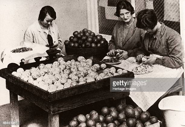 Women peeling lemons for the manufacture of Cloudy Lemon Squash 1923