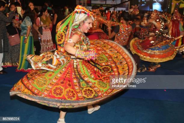 Women perform dandiya dance at 'Thane Raas Rang Navratri Festival' at Modella Mill Compound Thane on September 23 2017 in Mumbai India Dandiya Raas...