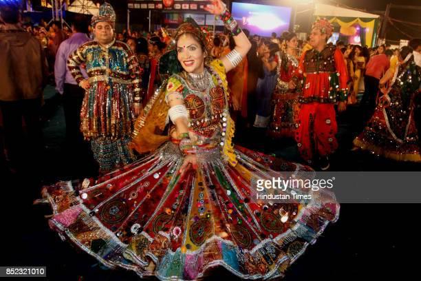 Women perform Dandiya dance at 'Thane Raas Rang Navratri Festival' during Navratri festival at Modella Mill Compound on September 22 2017 in Mumbai...