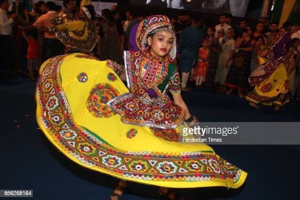 Women perform dandiya dance on the last day of 'Thane Raas Rang Navratri Festival' at Modella Mill Compound Thane on September 30 2017 in Mumbai...