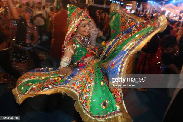 Women perform dandiya dance on the last day of 'Thane Raas Rang Navratri Festival' at Modella Mill Compound Thane on September 30 2017 in Mumbai...