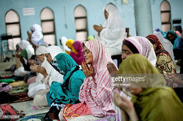 Women perform EidalAdha prayers at the National Mosque on October 16 2013 in Dhaka Bangladesh Eid AlAdha known as the 'Feast of the Sacrifice' is one...