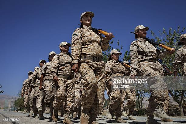 Women Peshmerga recruits some of whom are volunteers parade as they take part in a military training at a base near the northern Iraqi city of...