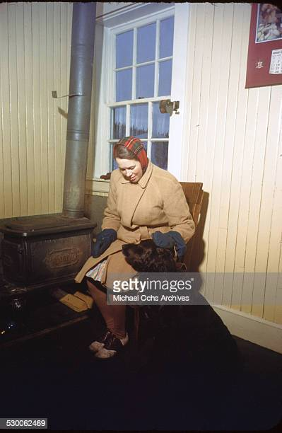 A women pets her dog at the Hudson Bay Trading Company in Goose BayLabrador NewfoundlandCanada