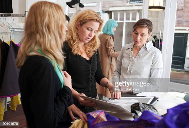 Women planning a fashion store opening