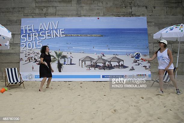 Women play beach tennis at the 'TelAviv sur Seine' beach attraction as part of the 14th edition of Paris Plages in central Paris on August 13 2015...