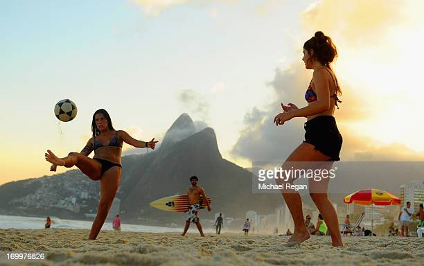 Women play football on Ipanema beach ahead of the FIFA Confederations Cup Brazil 2013 on June 5 2013 in Rio de Janeiro Brazil