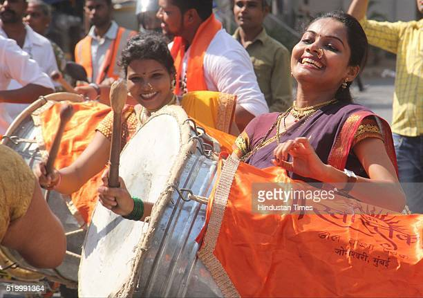 Women play the dhol during Gudi Padwa shobha yatra on the auspicious day of Gudi Padwa at Lokhandwala Complex Andheri on April 8 2016 in Mumbai India...