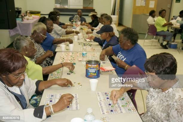 Women playing bingo at Charles Hadley Park community senior center