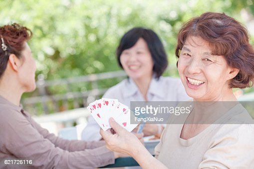 Women playing cards together