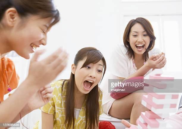 Women playing Jenga