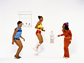Women playing jump rope against cartoon background