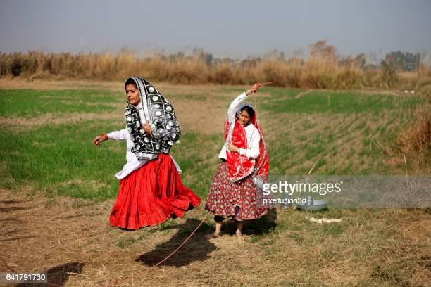 Women playing skipping rope game
