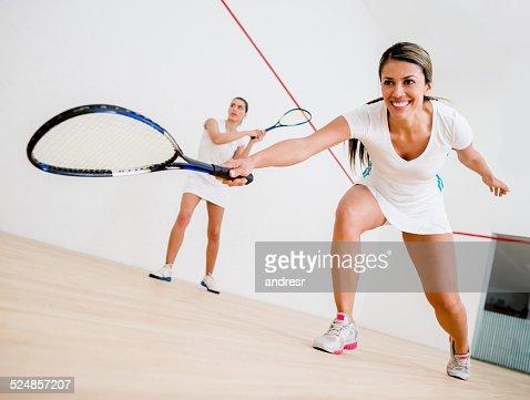 Women playing squash