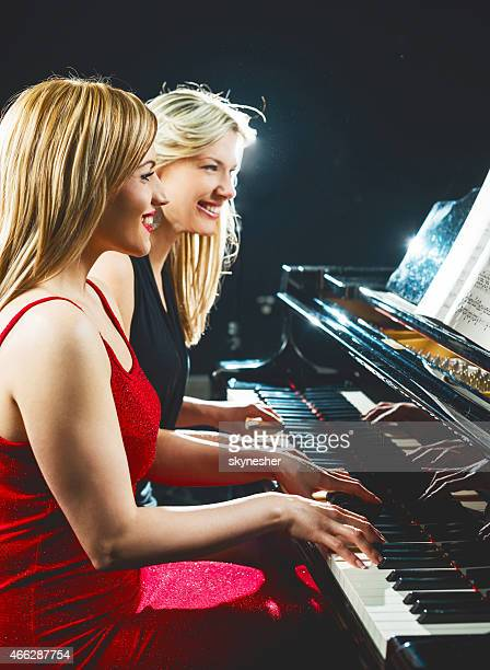 Women playing the piano.