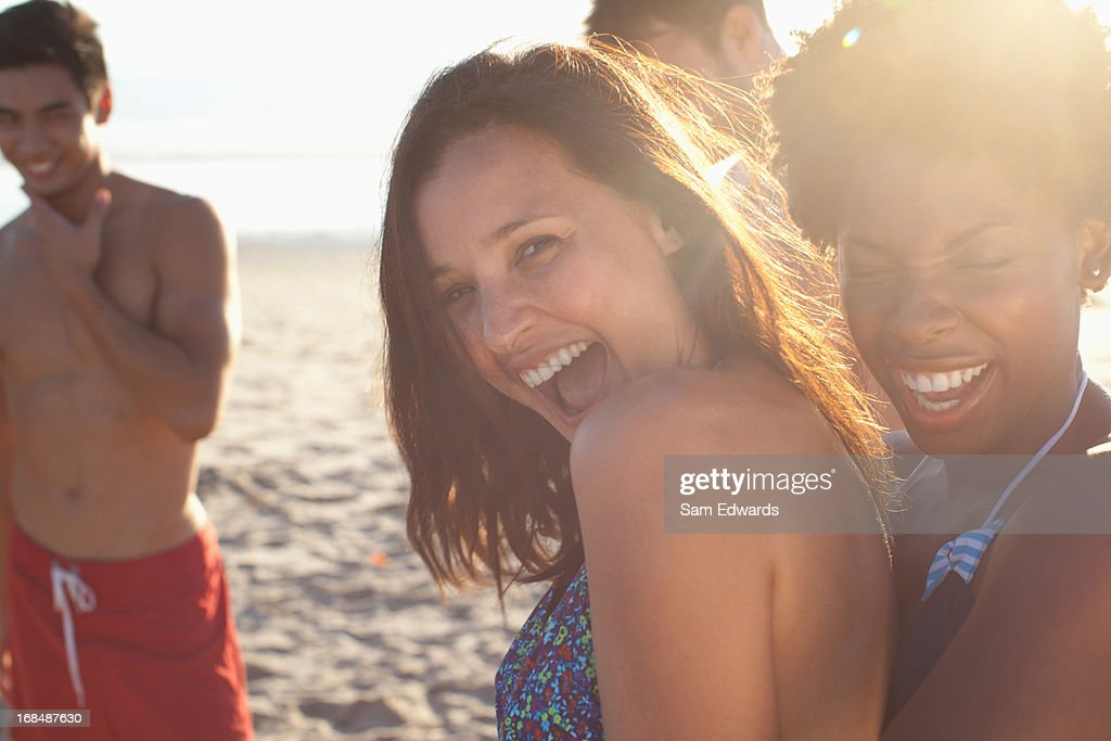 Women playing together on beach : Stock Photo