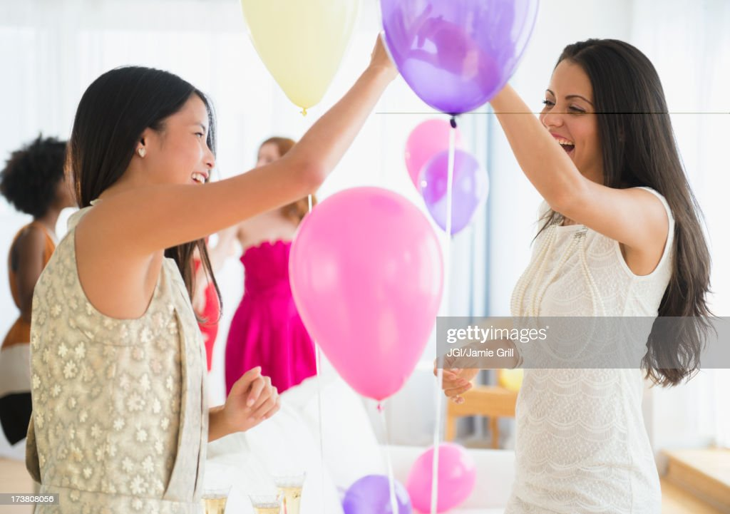 Women playing with balloons at party : Stock Photo