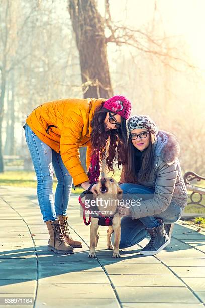 Women plays with her dog