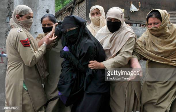 Women police detain female protesters during clashes at Lal Chowk on May 9 2017 in Srinagar India Clashes broke out between school students and...