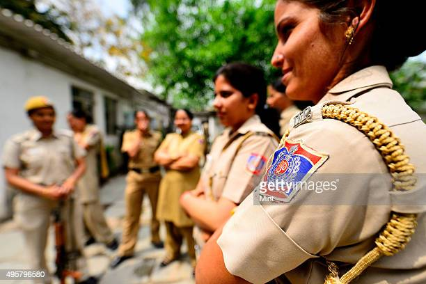 Women police on duty at Maurice Nagar Police Station near Delhi University on March 27 2014 in New Delhi India