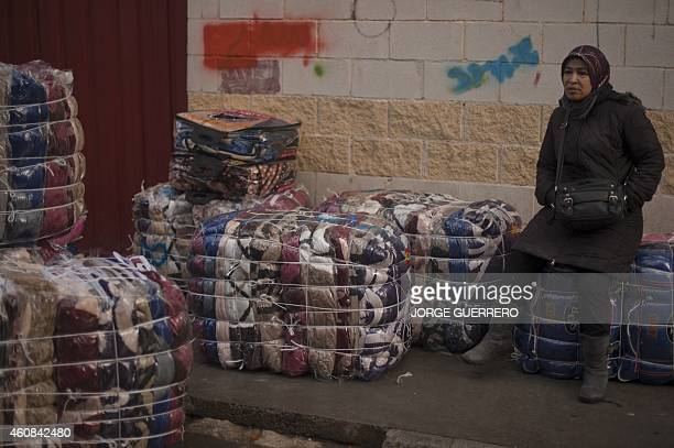 BAZINET A women porter rests on bundles destined for transport across the El Tarajal boarder separating Morocco and Spain's North African enclave of...