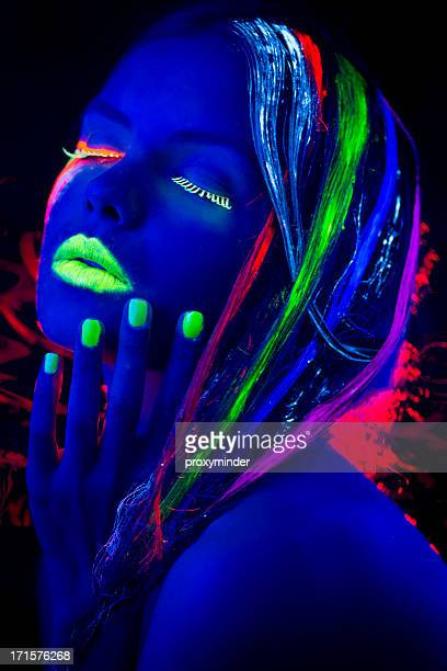 Women Portrait with Glowing Multi Colored Hair in black light