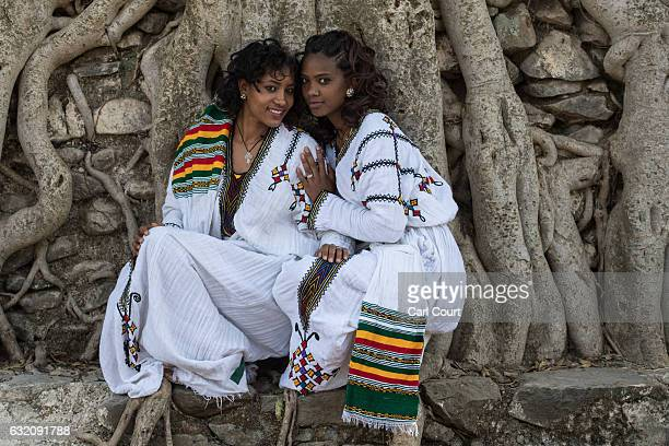 Women pose for a photograph in traditional Ethiopian dress during the annual Timkat Epiphany celebration on January 19 2017 in Gondar Ethiopia Timkat...
