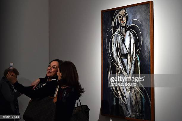 Women pose for a selfie in front of a painting by French artist Henri Matisse during a press preview of the exhibition 'Matisse Arabesque' on March 4...
