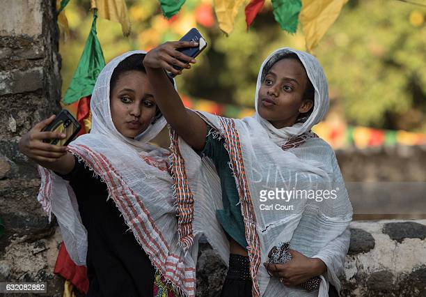 Women pose for a selfie photograph during the annual Timkat epiphany celebration on January 18 2017 in Gondar Ethiopia Timkat is the Ethiopian...