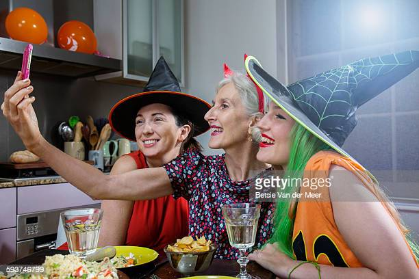 Women Pose for Selfie, dressed up for Halloween.