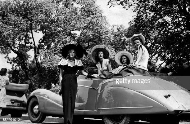 Women pose in a car during an elegance contest in Paris in 1948 / AFP PHOTO /