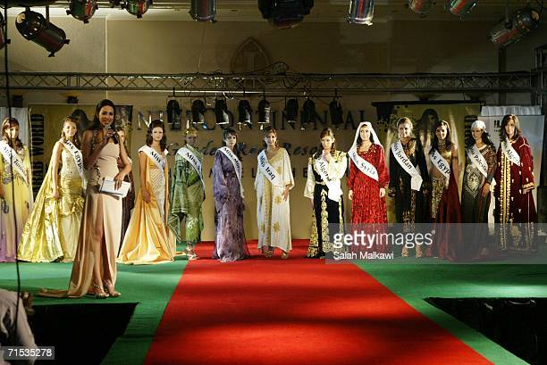 Women pose in traditional dresses of their countries July 29 2006 in Sharm El Sheikh Egypt Thirteen women who represent nine Arab countries...