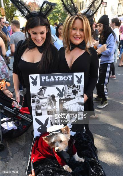 Women pose with their dog in costume during the 27th Annual Tompkins Square Halloween Dog Parade in Tompkins Square Park in New York on October 21...