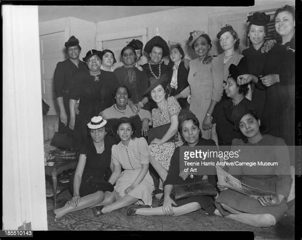 Women posed in Julia Calloway's Mooseheart Street home Pittsburgh Pennsylvania 1941 Including Edith Whitaker Nellie Kent Mary Harris Frances Johnson...