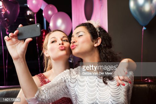 Women posing and taking photo on mobile phone. : Stock Photo