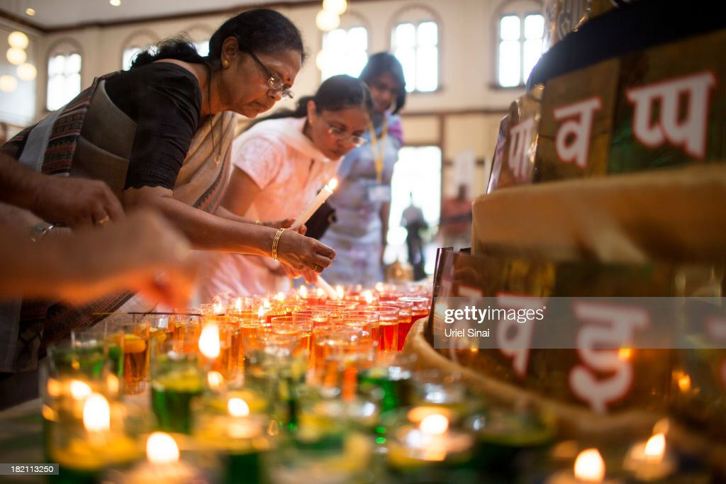 Women pray and light candles as the Jain community hold a 24 hour prayer for the victims of the Westgate Shopping Centre attack on September 28, 2013 in Nairobi, Kenya. Officals begun the task of forensic probing the Westgate shopping mall following a four-day siege that killed 67 civilians and police and was claimed by the Somali militant group al Shabaab.