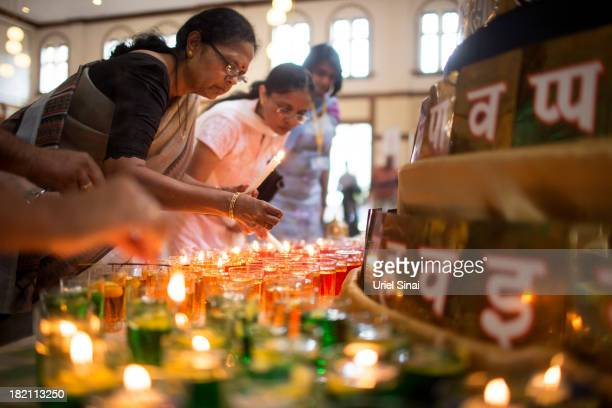 Women pray and light candles as the Jain community hold a 24 hour prayer for the victims of the Westgate Shopping Centre attack on September 28 2013...