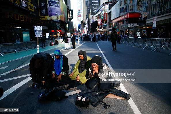 Women pray as people take part in a rally dubbed I Am A Muslim Too in a show of solidarity with American Muslims at Times Square on February 19 2017...