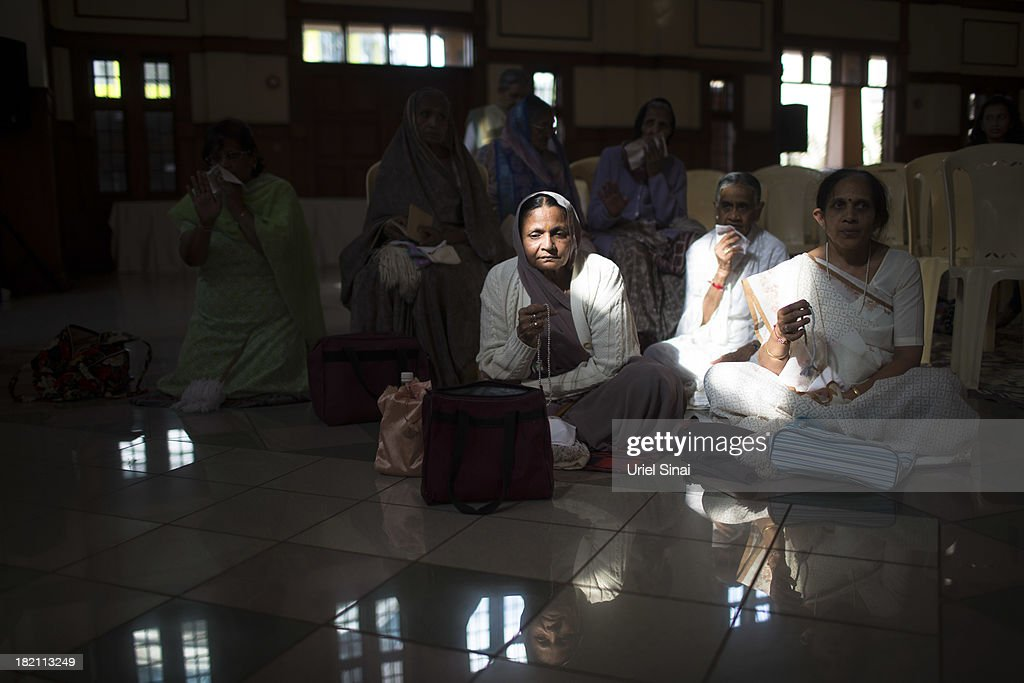 Women pray as the Jain community hold a 24 hour prayer for the victims of the Westgate Shopping Centre attack on September 28 2013 in Nairobi Kenya...