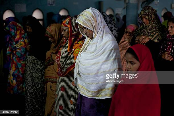 Women pray at the National Mosque during the EidalAdha holiday October 6 2014 in Dhaka Bangladesh Eid AlAdha known as the 'Feast of the Sacrifice' is...