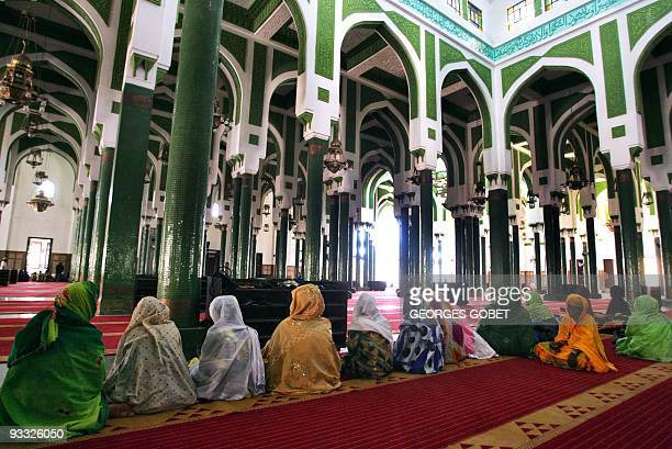 Women pray in Faisal Mosque 26 February 2007 in Conakry Religious ceremonies in memory of victims of a lethal state crackdown are marking the last...