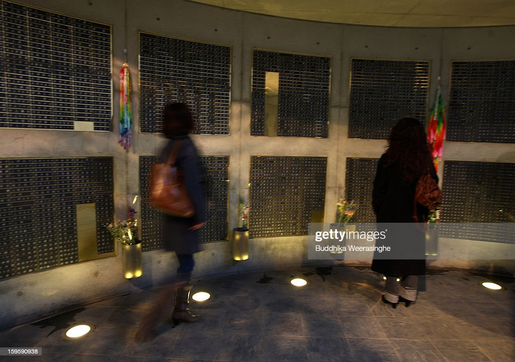 Women pray in front of plates showing the names of the victims in the 1995 'Great Hanshin earthquake' during a memorial ceremony on January 17, 2013 in Kobe, Japan. Memorial services were held to mark the 18th anniversary of the 1995 massive earthquake, hundreds of people gathered early this morning to pay their respects and light bamboo lanterns in the park for more than 6,400 people who lost their lives in the 7.3 magnitude earthquake.