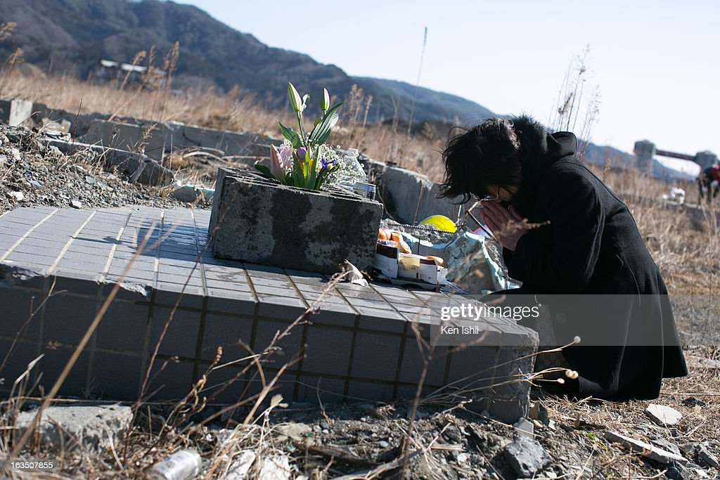 A women prays for her family where her house used to stand on March 11, 2013 in Ootsuti, Iwate prefecture, Japan. On March 11 Japan commemorates the second anniversary of the magnitude 9.0 earthquake and tsunami that claimed more than 18,000 lives.