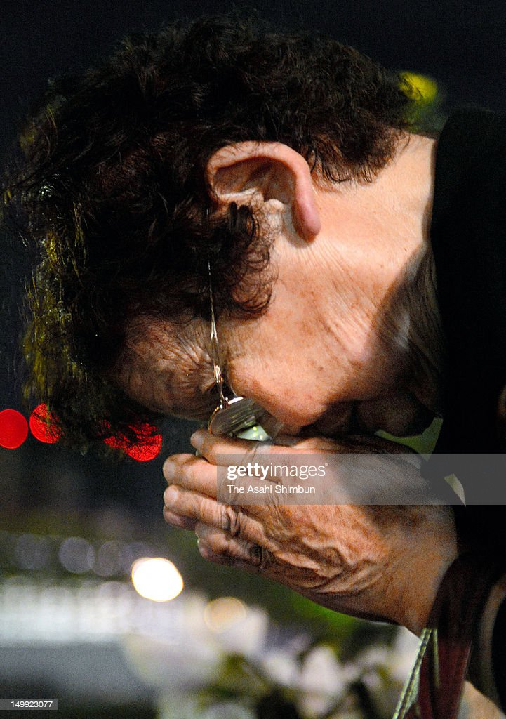 A women prays for the atmic bomb victims at a monument at the Hiroshima Memorial Park on August 6, 2012 in Hiroshima, Japan. Hiroshima marks the 67th anniversary of its atomic bombing under the shadow of the Fukushima nuclear disaster and by issuing a plea for complete nuclear disarmament.